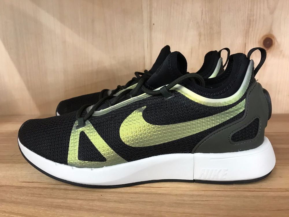f2a1712838a4 Nike Womens Duel Racer Low Top Lace Up Running Sneaker